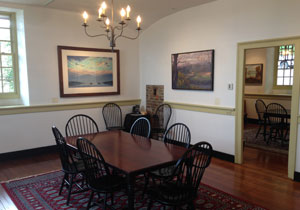 Table and Chairs at the Zimmerman Center with artwork on walls